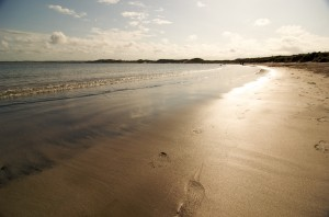 Footprints in the sand at Beadnell Bay - Photo by www.BenPattersonPhotography.com